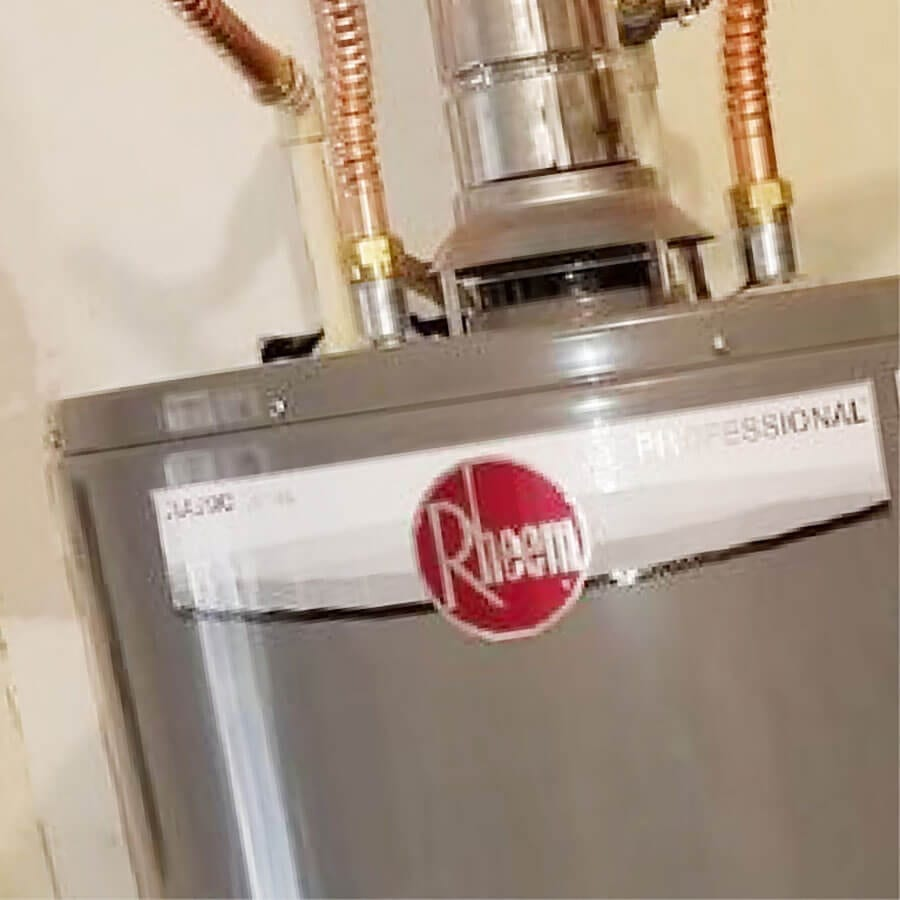 Grey and red Rheem electric water heater with installation