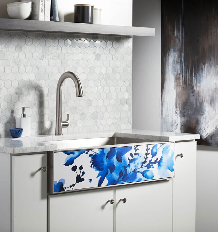 This grey and white kichen sink shows tenant remodeling and tenant improvement services