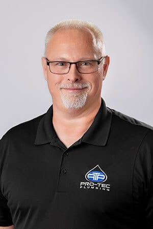 Headshot of Pro-Tec Plumbing employee and general manager Brian Finger