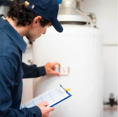 Man checking a meter on a water heater